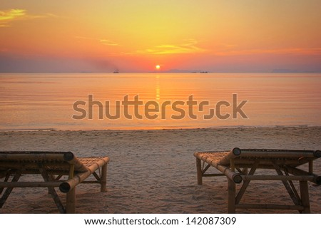 Sunbeds on the beach at sunset