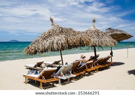 Sunbeds on the beach in Hoi An, Vietnam. - stock photo