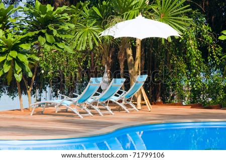Sunbeds on the beach in Thailand - stock photo
