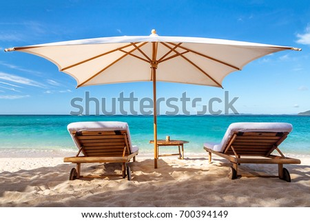 Sunbeds under the umbrella front of the lagoon