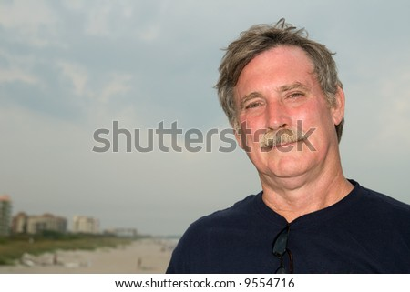 sunburned man at Cocoa Beach, Florida - stock photo