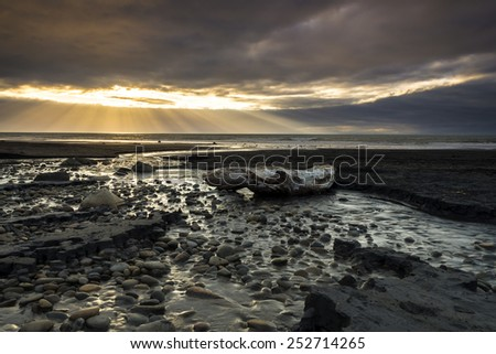 Sunburst at coast of New Plymouth, New Zealand - stock photo