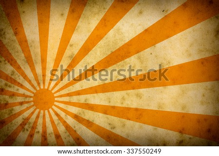 sunburst of yellow rays on a grungy,dirty background - stock photo