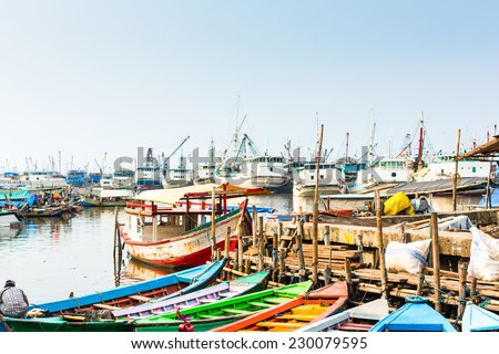 Sunda Kelapa old Harbour  with fishing boats, ship and docks in Jakarta, Indonesia  - stock photo