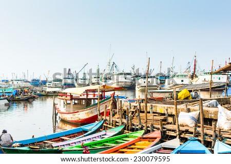 Sunda Kelapa old Harbour  with fishing boats, ship and docks in Jakarta, Indonesia  - stock photo