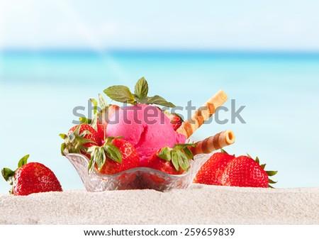 Sundae on sand with tropical beach  - stock photo