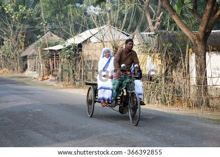 SUNDARBANS, INDIA - JANUARY 14: Sisters of Missionaries of Charity of Mother Teresa by rickshaw visit patients in the Sundarbans area of the jungle, on January 14, 2009 in West Bengal, India. - stock photo
