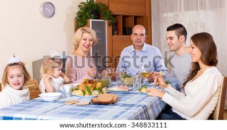 Sunday dinner in the bosom of family indoor - stock photo