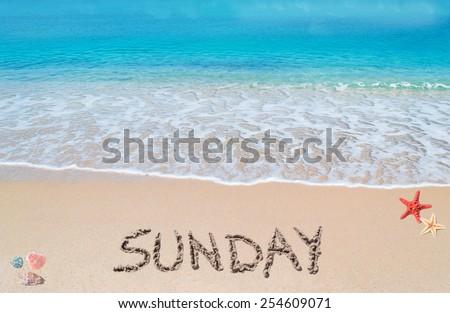 sunday written on a tropical beach - stock photo