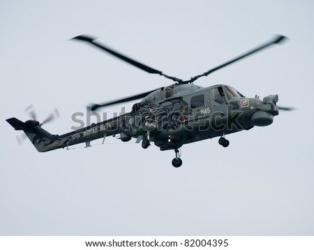 SUNDERLAND, UK - JULY 31: A Royal Navy helicopter performs at the Sunderland International Airshow on July 31, 2011 in Sunderland, UK. - stock photo