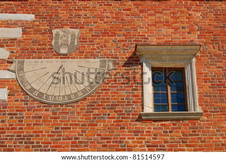 Sundial - old town hall in Sandomierz, Poland. The town hall was build in the XIV century and the tower was build in the XVII century. - stock photo