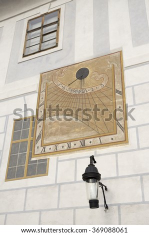 sundial on the white wall of the house a cloudy day did not show time - stock photo