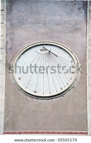 Sundial on wall. Dolceacqua, Italy. A sundial is a device that measures time by the position of the Sun. - stock photo