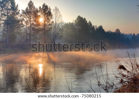 Sundise over the river - stock photo