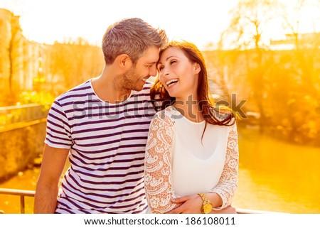sundown city couple with yellow light - stock photo
