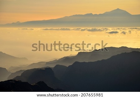 Sundown from Gran canaria with Tenerife island and peak of Teide in background
