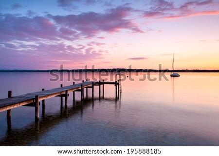 sundown on alpine lake, Lake Starnberger Germany - stock photo