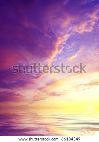Sundown on sea with bright colour and glow sun - stock photo