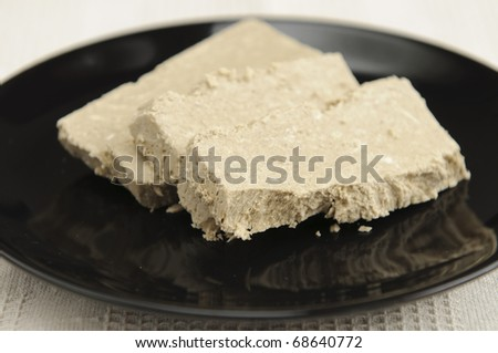 Sunflower halva, popular in countries from Eastern Europe, such as Armenia, Belarus, Bulgaria, Romania, Moldova, Russia, Poland, and Ukraine, is made of sunflower seeds instead of sesame. - stock photo