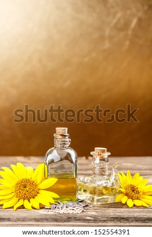 Sunflower oil and olive oil with space for your text - stock photo