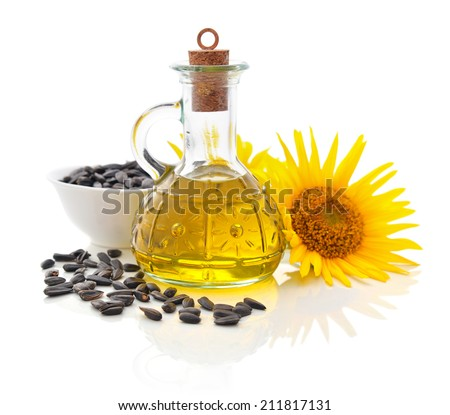 Sunflower oil in bottle with seeds and flower isolated  on white background - stock photo