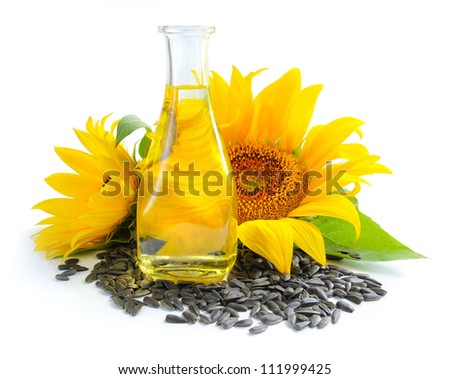 Sunflower oil is with the flowers of sunflower and grain on white background - stock photo