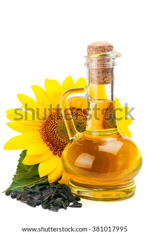 Sunflower oil, seeds and flower isolated on white background - stock photo