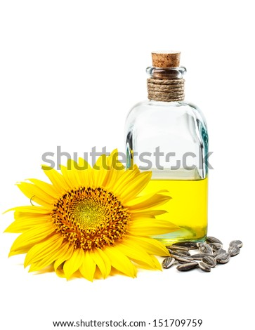 Sunflower oil with flower and seeds - stock photo