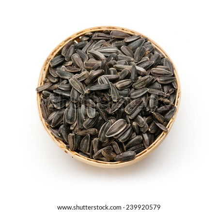 Sunflower seed in wooden basket on white background - stock photo