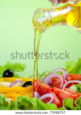 sunflower seed oil stream and healthy fresh vegetable salad - stock photo