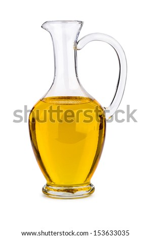 Sunflower seed (or olive, or corn) oil in glass decanter isolated on white background - stock photo