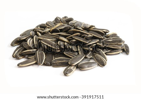 Sunflower seeds in white background.