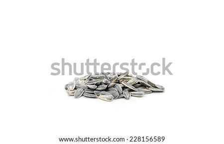 Sunflower seeds isolated over a white background. - stock photo