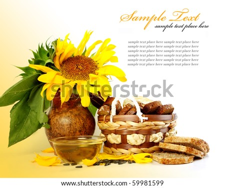 sunflower with green leaves and bread. Isolated over white background