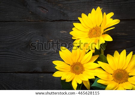 Sunflowers at wooden table. View from above with copy space.