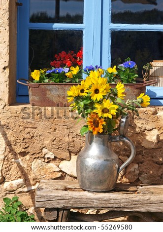 sunflowers in a pewter pitcher  in Provence - stock photo