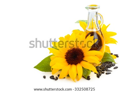 Sunflowers, sunflower oil and sunflower seeds. Isolated on white background.  - stock photo