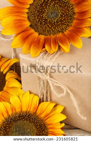 Sunflowers with present boxes close up