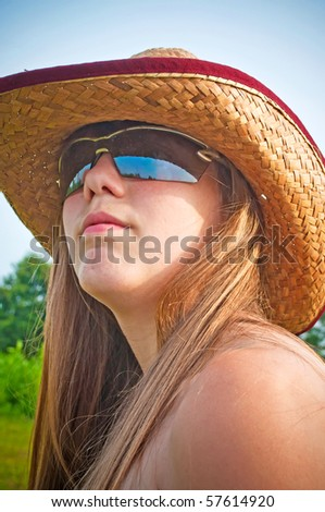 Sunglasses and a hat for protection from the sun - stock photo