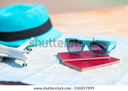 Sunglasses and passports, miniature airplane on the map. Travelling concept - stock photo