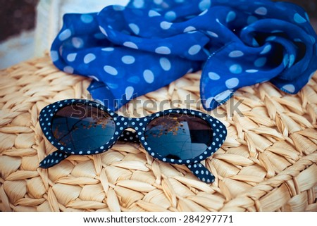 Sunglasses and scarf - stock photo