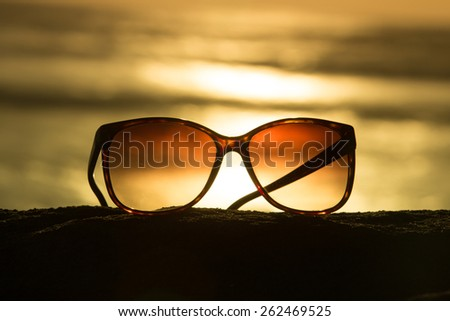 Sunglasses at Sunset Overlooking Beach