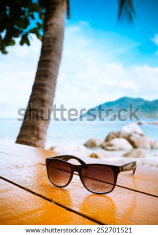 Sunglasses at the beach - stock photo