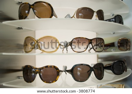 Sunglasses displayed in a shop - stock photo