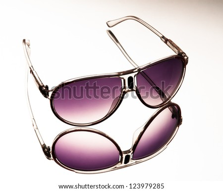sunglasses on a gradient mirror background - stock photo