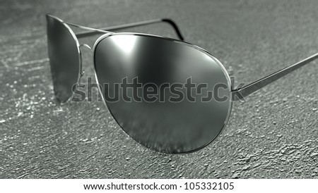 Sunglasses on a particular and modern surface