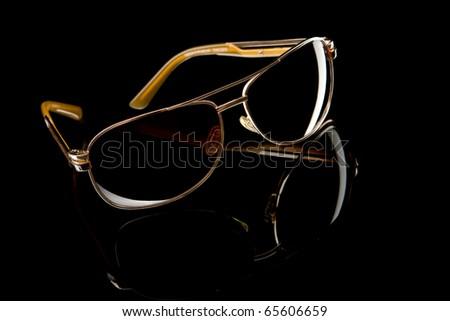 Sunglasses on black background - stock photo