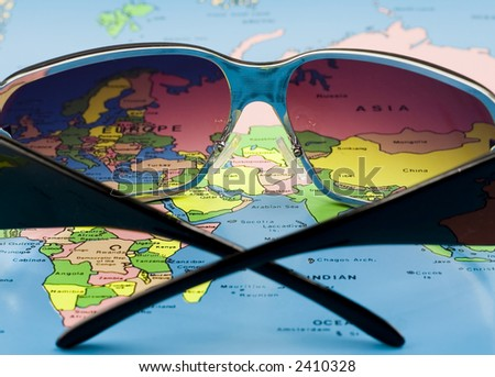 Sunglasses on the map - stock photo