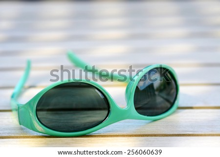 Sunglasses on the vintage wooden table - stock photo
