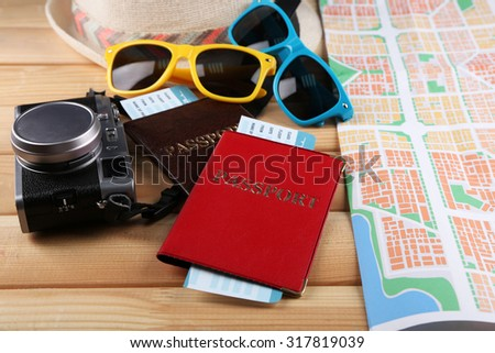 Sunglasses, passport and map, close up, on wooden background. Preparing for travel concept - stock photo